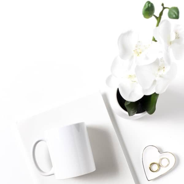 orchid plant, a cup and a pad of paper